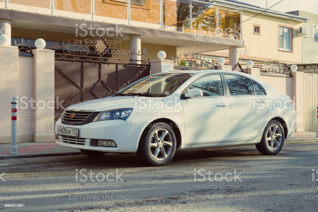 New chinese auto Geely Emgrand parked in russian city Sochi. stock photo