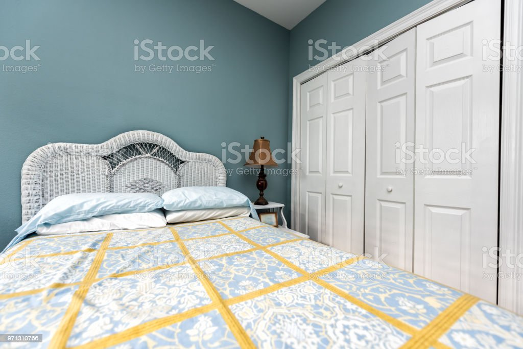 New clean bed comforter with headboard, table, lamp, vintage beach...