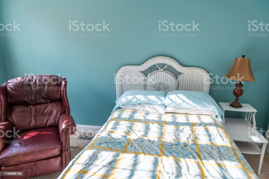 New Clean Bed Comforter With Wicker Rattan Headboard Table Vintage Beach Blue Pillows In Bedroom In Home House With Leather Mahogany Armchair Stock Photo Download Image Now Istock