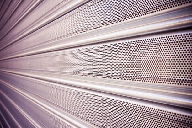 New closed metallic shutter door with perforated sheet stock photo