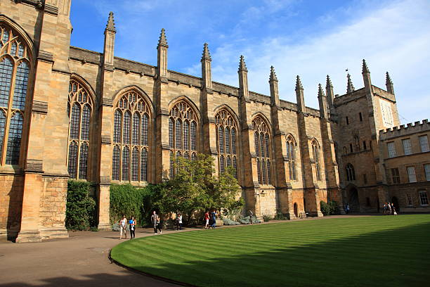 New College Oxford, England Oxford, United Kingdom - October 1, 2011: New College, at Oxford University, or it's full title the New College of St Mary. College square with visiting people. pejft stock pictures, royalty-free photos & images