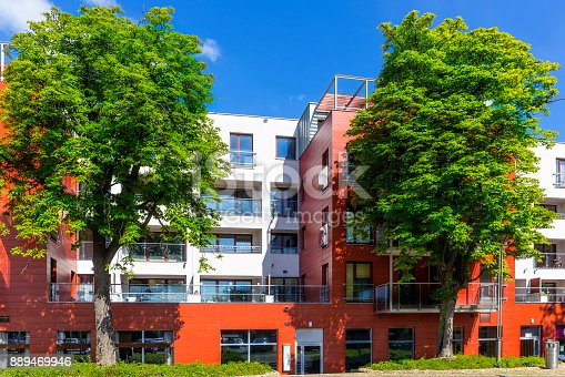 889473004 istock photo New colorful apartment building facade 889469946