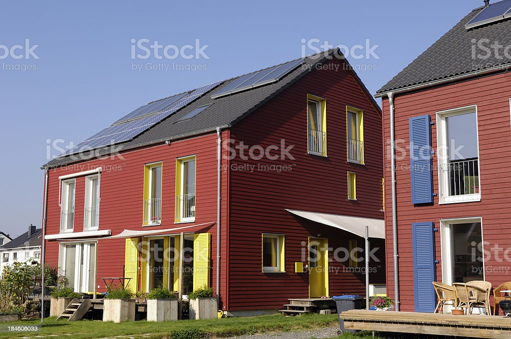 New colorful family houses with wooden cover panels royalty-free stock photo