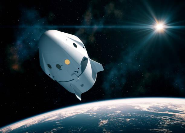 nieuwe commerciële ruimte capsule orbijten planeet aarde - ruimtevaart voertuig stockfoto's en -beelden
