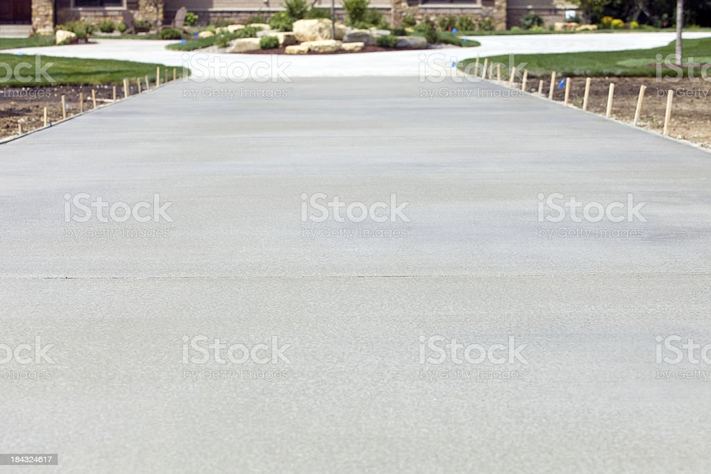 New Concrete Driveway Leads to Expensive House stock photo