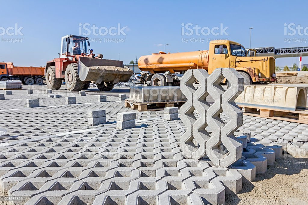 New concrete prefabricated drainage parts for parking lot at bui stock photo