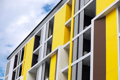 New condominum with yellow facade in Bangkok