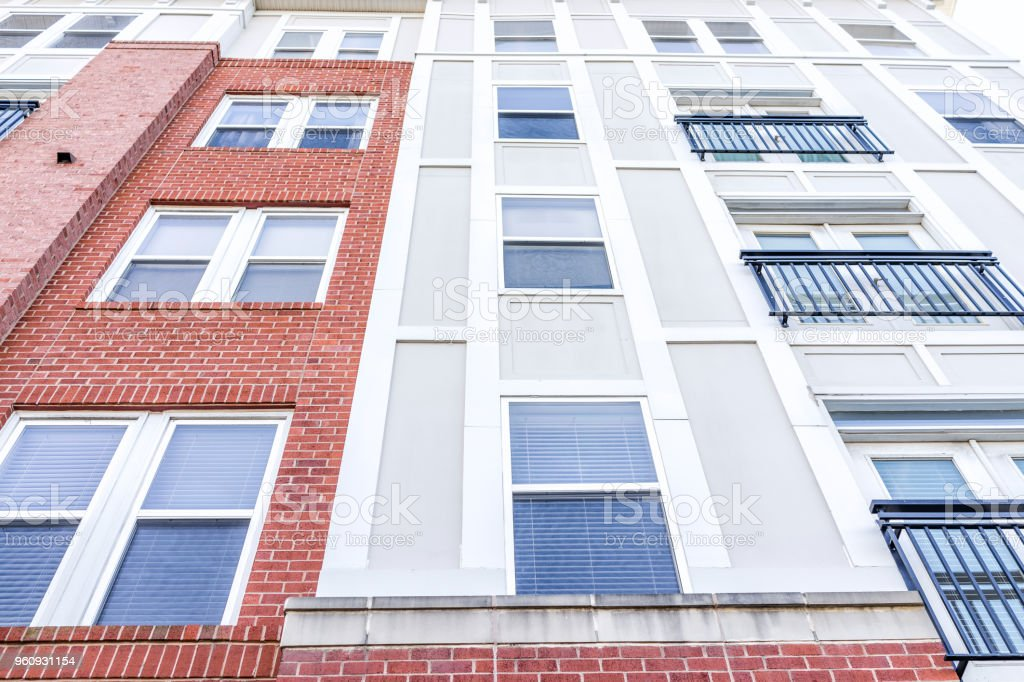 New construction exterior pattern of apartment condo, condominiums residential windows with brick colorful colors, modern siding in Virginia stock photo
