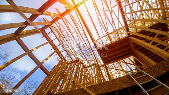 istock New construction framing house with frame 1082014314