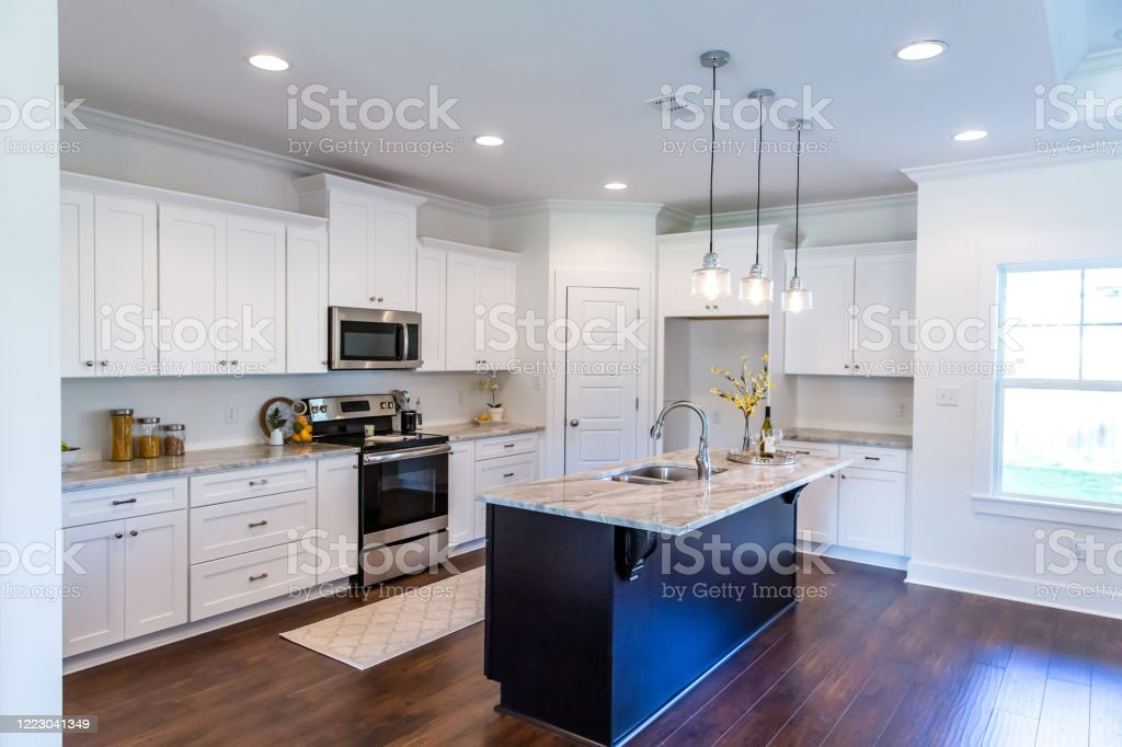 New Construction Modern Kitchen With White Cabinets And Hardwood Floors Stock Photo Download Image Now Istock