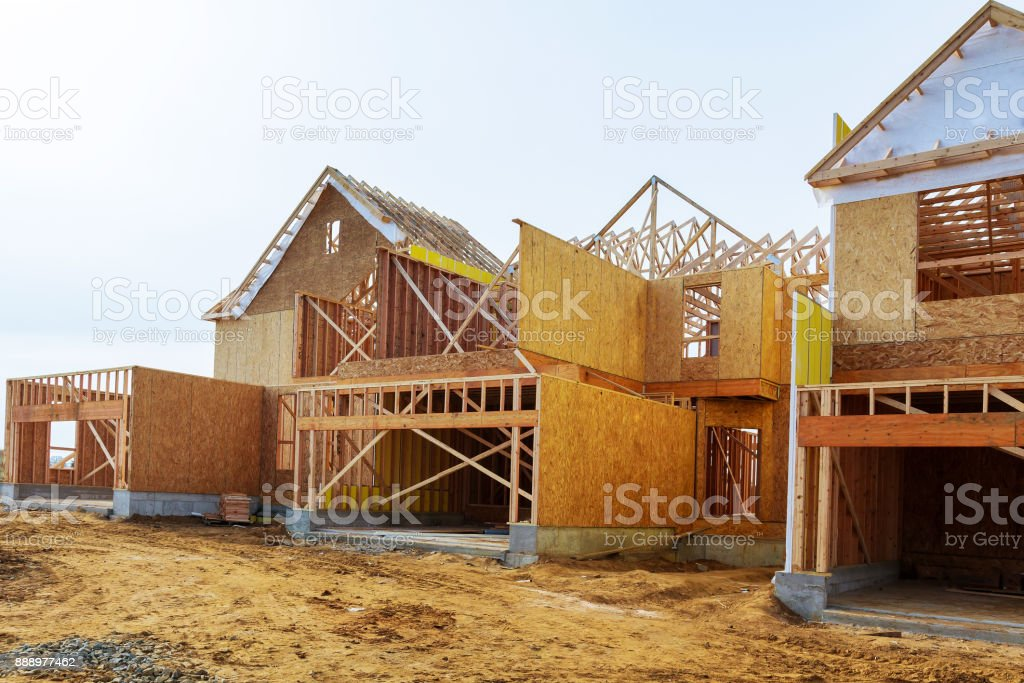 New construction of a house Framed New Construction of a House Building a new house from the ground up stock photo