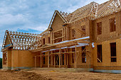 istock New construction of beam construction house framed the ground up 1144372578