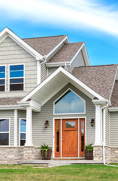 New Construction -Siding, Roof, Gutters, Entry Door stock photo