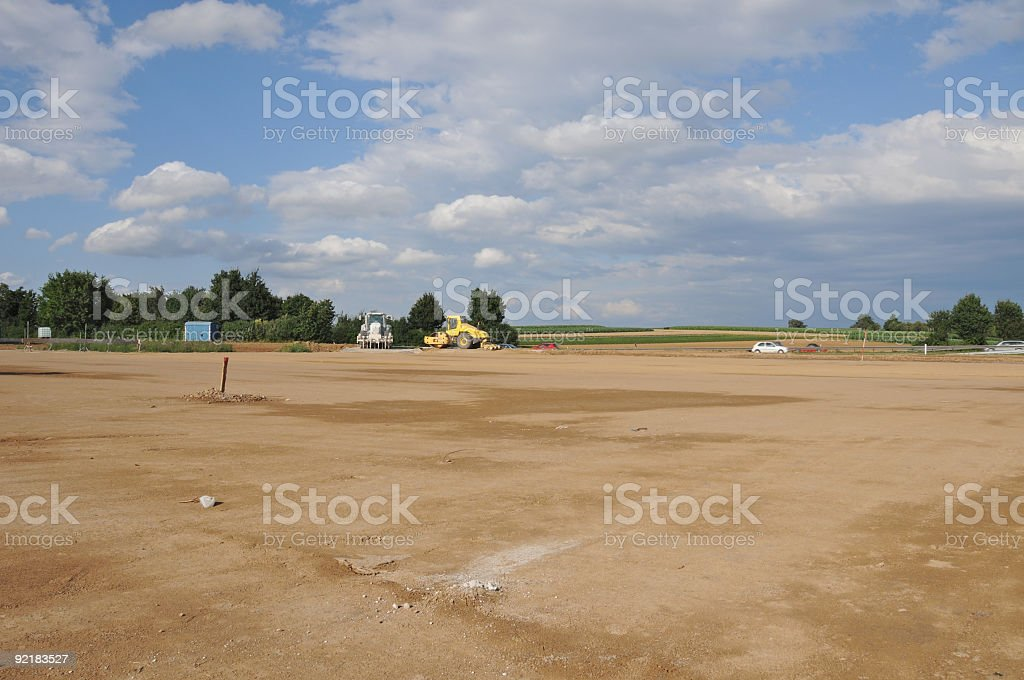 New construction site empty levelled ground farmland soil sealing stock photo