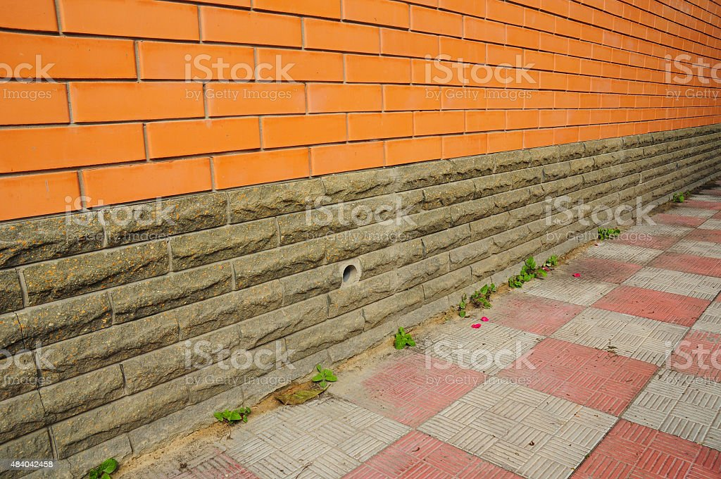 New construction waterproofing basement walls with detail of a pavement stock photo
