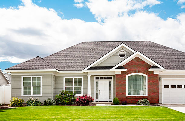 New Contemporary Home New upscale  contemporary home with front lawn. detached house stock pictures, royalty-free photos & images