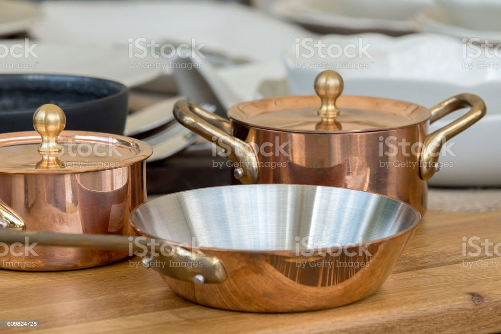 new copper cookware - pots and pans stock photo