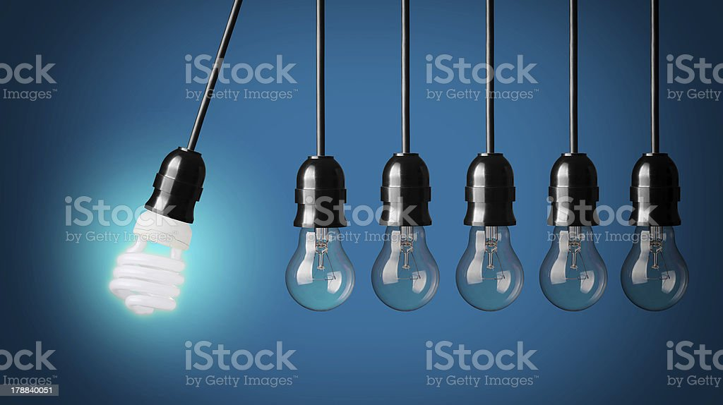 New creativity concept with a lightbulb on in white light stock photo