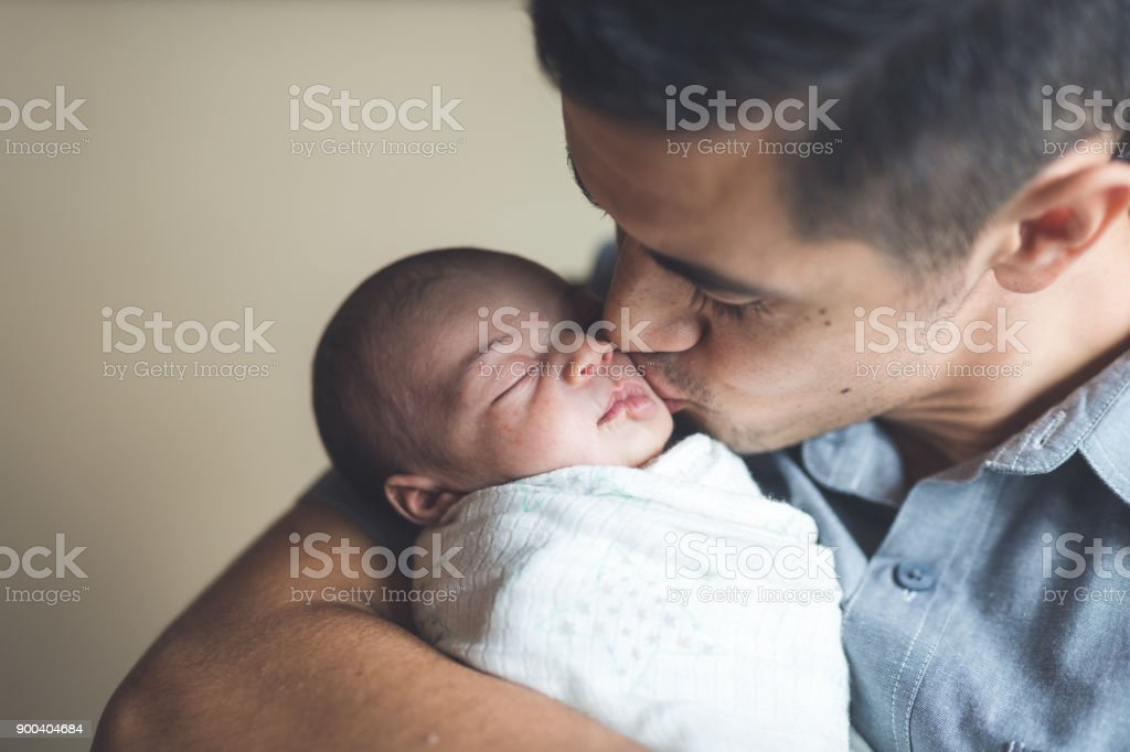 New Dad Holding Infant Daughter stock photo