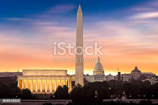 New Dawn over Washington - with 3 iconic monuments illuminated at sunrise: Lincoln Memorial, Washington Monument and the Capitol Building.