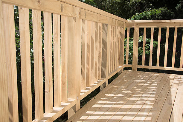New deck patio built of wood, pine timber Newly built deck pine wood material stock pictures, royalty-free photos & images