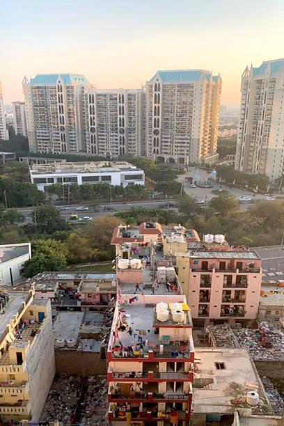 New Delhi, India rich next to poor neighborhood. stock photo