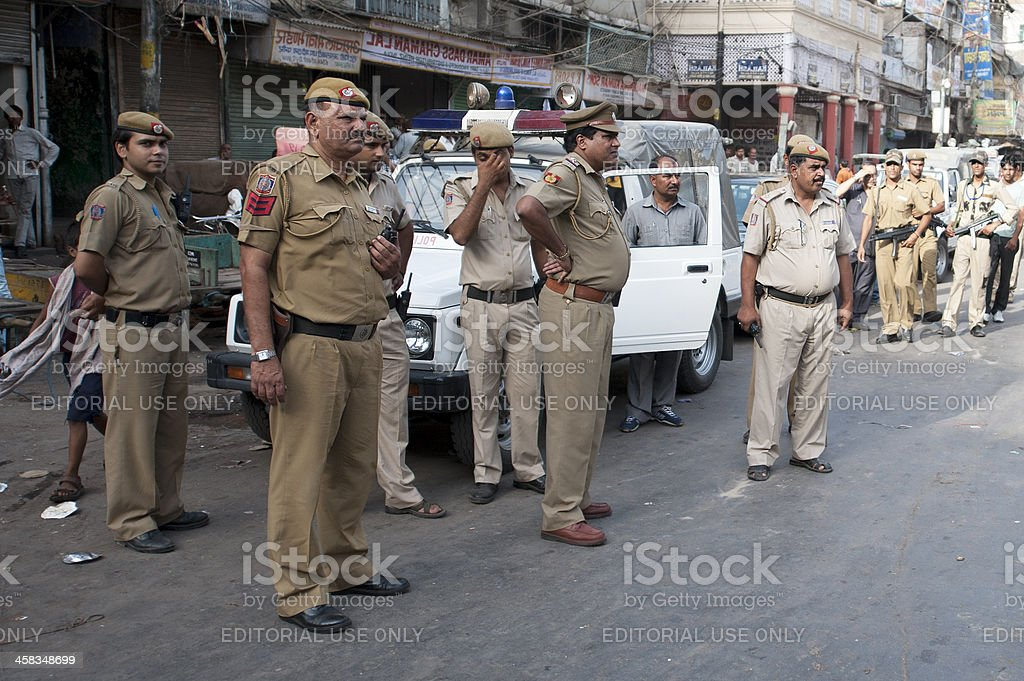 New Delhi Police Patrol Spice Market royalty-free stock photo