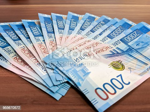 istock New design of russian money. Two thouthands rubles banknotes on the wooden table 955670572
