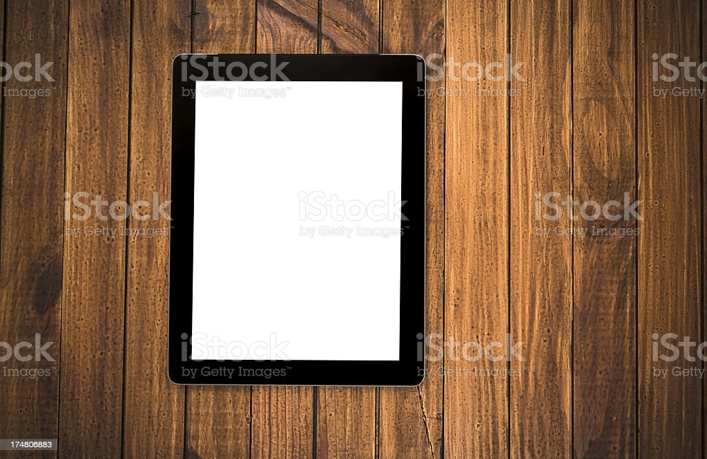 New digital tablet on wood rustic table royalty-free stock photo