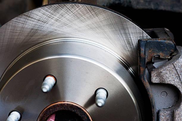 nouveau disque de frein rotor-gros plan - disque de frein photos et images de collection
