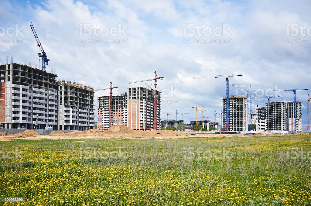 New district. Build house with green field and yellow flowers and...