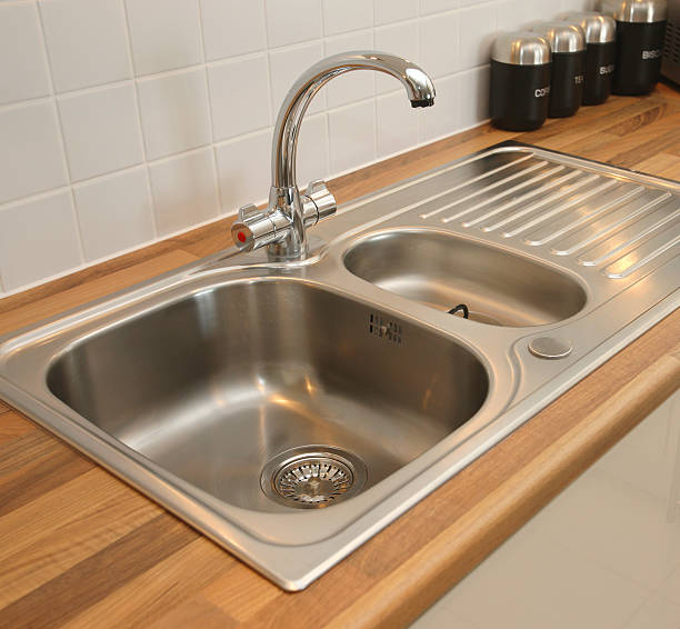 new domestic kitchen sink - kitchen sink stock photos and pictures