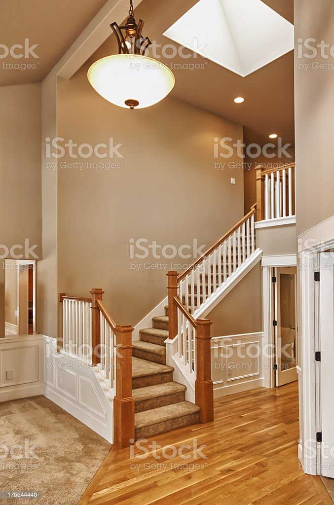 New double foyer stairs and hardwood floors stock photo