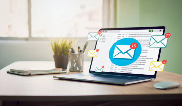 New email alert on laptop, communication connection message to global letters in the workplace. stock photo