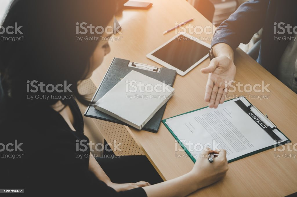 New Employee have been invited to sign work contract after successful job interview stock photo