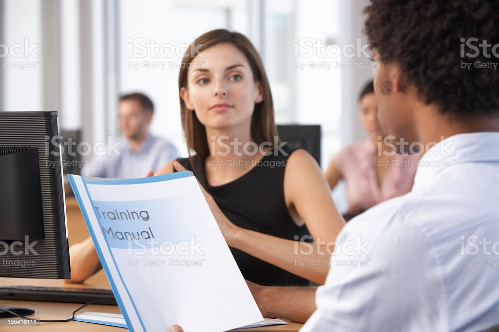 New Employee Starting Work In Busy Office royalty-free stock photo