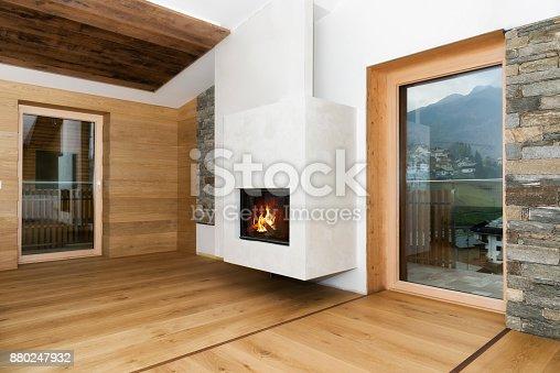 istock new empty living room interior with fireplace and hardwood floor 880247932