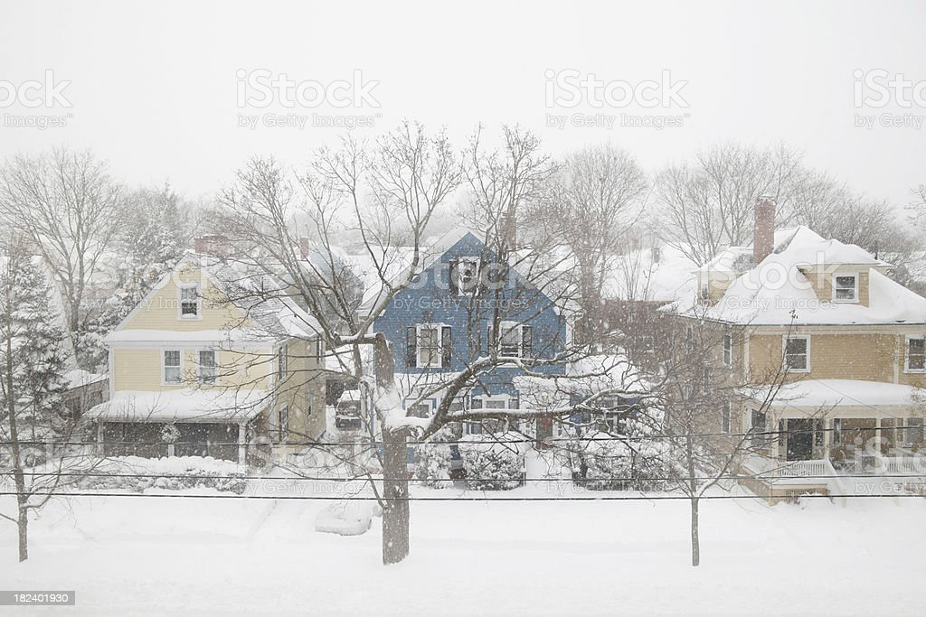 New england colonials in snowstorm stock photo