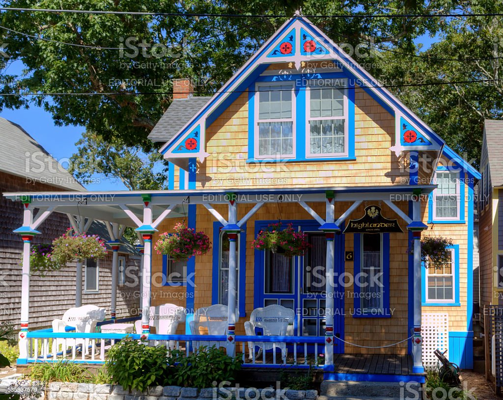 New England House (Cottage) in Oak Bluffs, Martha's Vineyard, Massachusetts. Martha's Vineyard, MA, USA - September 17, 2014: Historic Cottage in Trinity Park (Campground area), Oak Bluffs, Martha's Vineyard, on a beautiful autumn day. Martha's Vineyard is an island located south of Cape Cod in Massachusetts and is famous as an affluent summer colony. HDR photorealistic image. 2015 Stock Photo