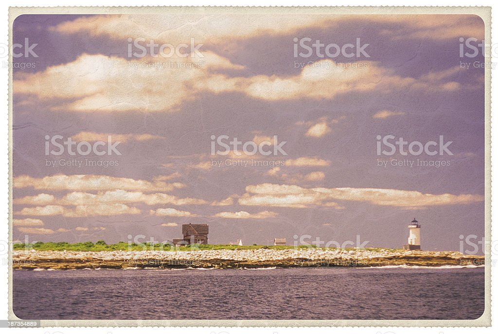 New England Lighthouse and Cottage - Vintage Postcard stock photo