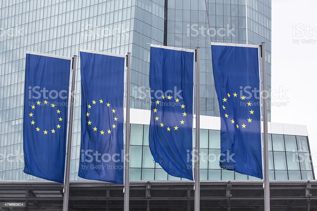 new european central bank in frankfurt germany with europe flags stock photo