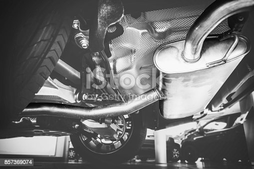 853517784 istock photo New exhaust under the car 857369074