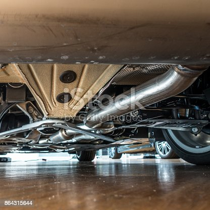 853517784 istock photo New exhaust under the car 864315644