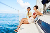 Shot of two happy young women enjoying a relaxing day on a yacht