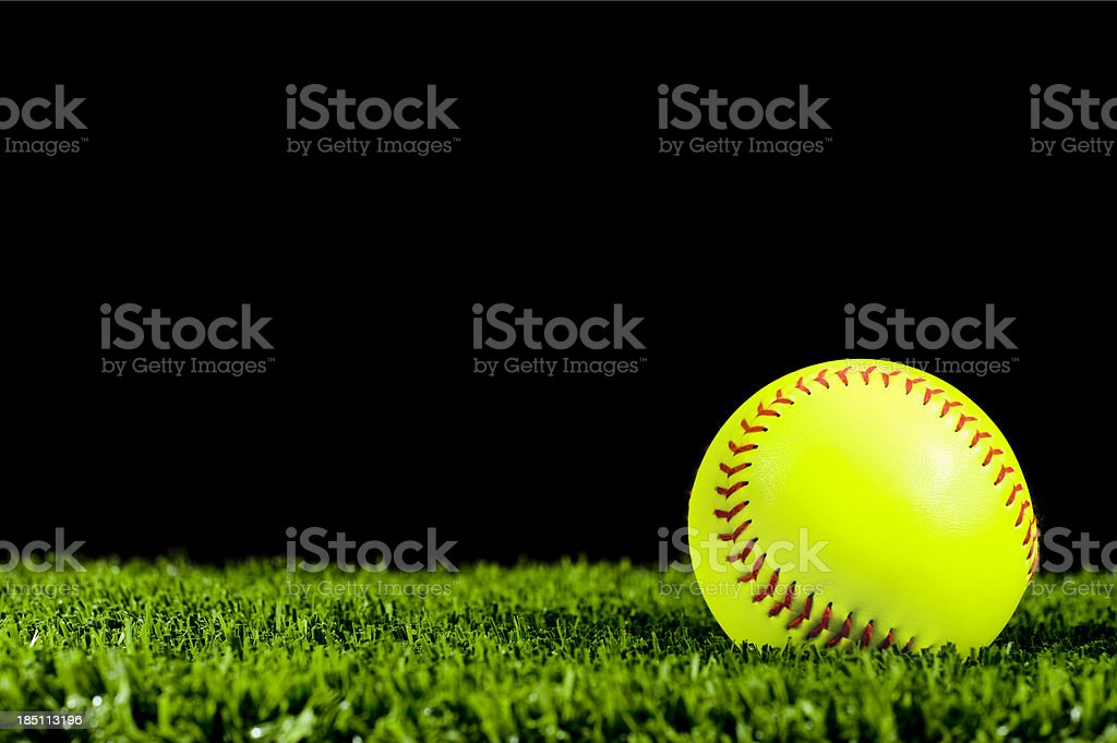 New Fast Pitch Softball in Grass for Night Game royalty-free stock photo