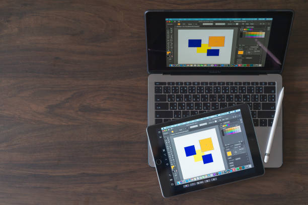 New features Sidecar on macOS in Macbook pro and iPadOS on iPad2018. Sidecar have Extended desktop, Mirrored desktop features for drawing Adobe Ilustrator. stock photo