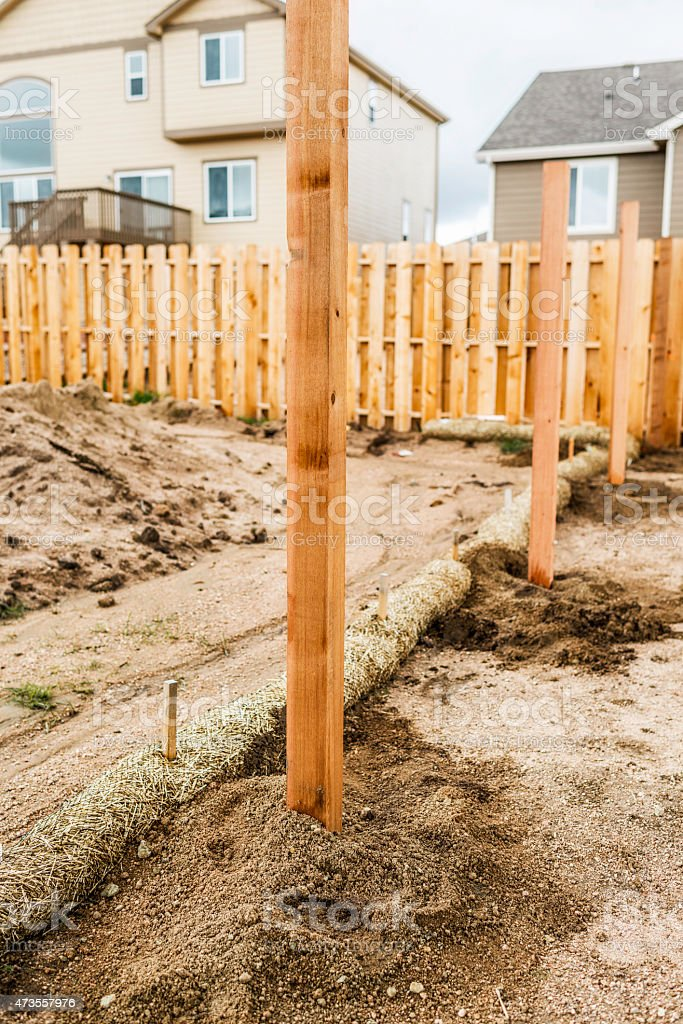New fence construction. Fence posts cemented into ground
