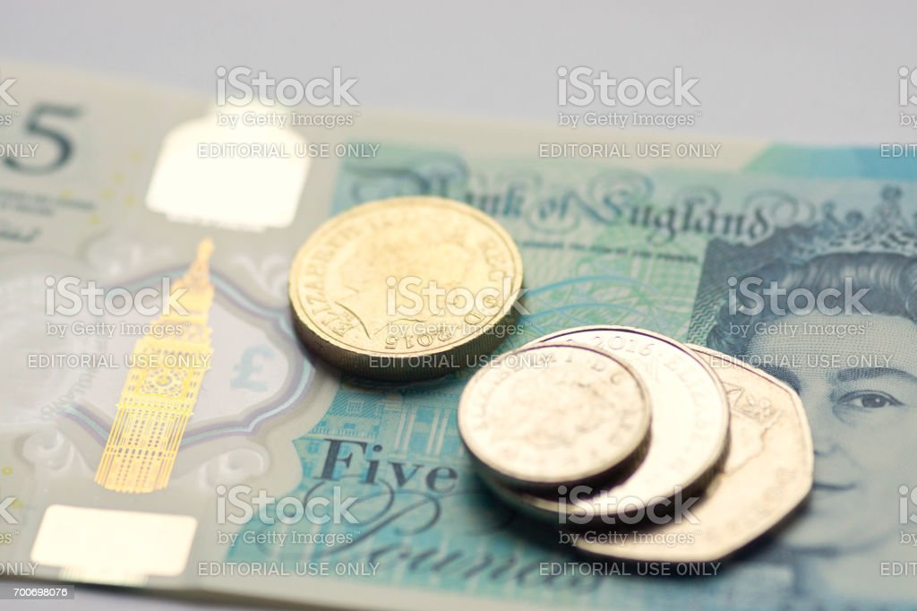 New five pound note and change stock photo