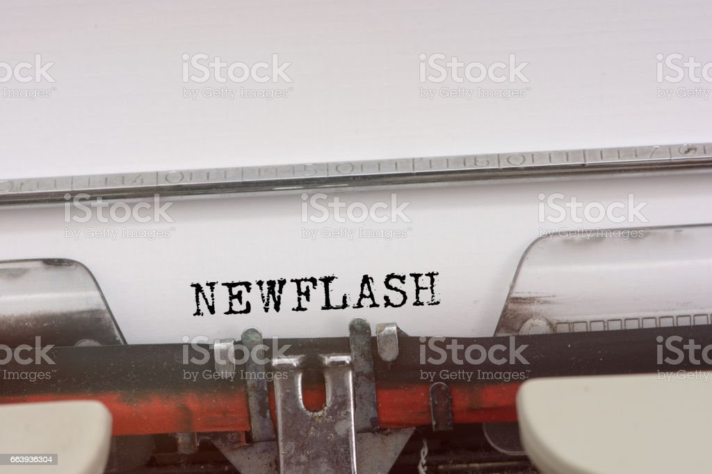 New flash word typed on a Vintage Typewriter. stock photo