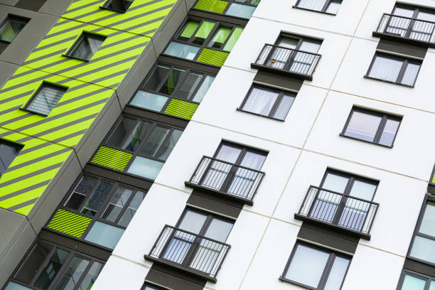 New freshly painted in white, light green and grey block of flats stock photo